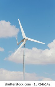 wind turbine on blue sky background