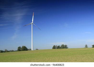 Wind turbine on the field crops