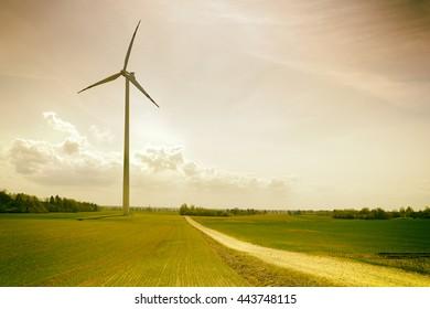 Wind turbine on a green field