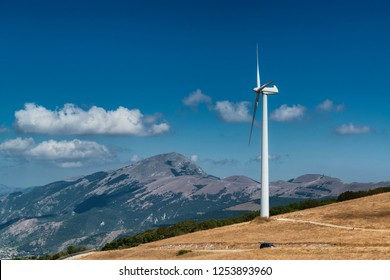 Wind turbine on the top of a mountain in Nothern Italy. Clean enviroment friendly energy.