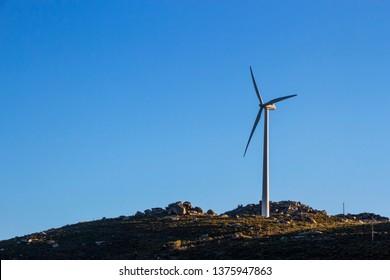 Wind turbine on top of the mountain