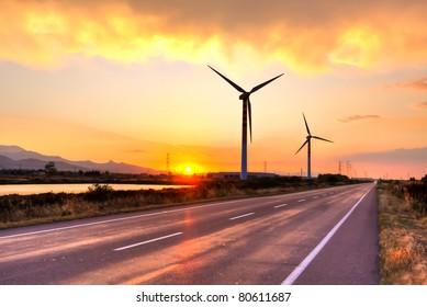 Wind turbine over beautiful sunset