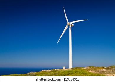 Wind turbine over blue sky on Crete, Greece
