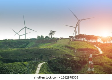 Wind turbine power generator farm at beautiful sunset background