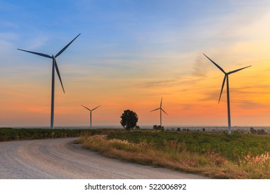 Wind turbine power generator farm at sunset