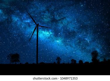 Wind turbine power generator on galaxy background.