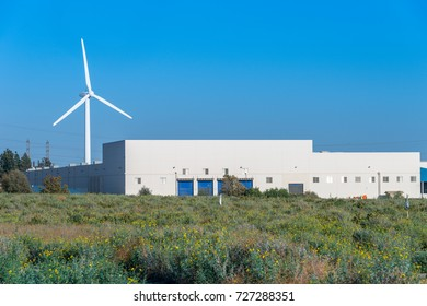 Wind Turbine and Power Station and Field of Yellow Flowers