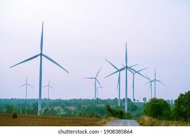 Wind turbine renewable energy source summer with sky