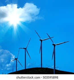 wind turbine in a row over blue background