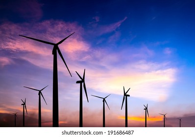 wind turbine silhouette on colorful sunset abstract for green earth concept