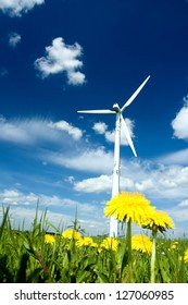 Wind Turbine in a Summer Meadow with yellow Dandelions