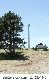 Wind turbine tower without blades. Russia, Republic of Crimea. 06.13.2018. Wind generator without blades on top of Mount Ai-Petri