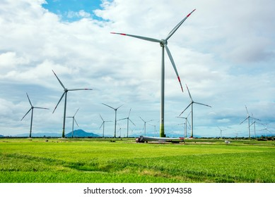 Wind turbine transportation and construction in big green field blue sky to generate renewable clean energy