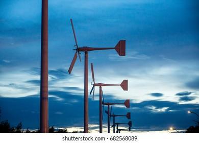 Wind turbine at twilight sunset. Wind turbine generating electricity.