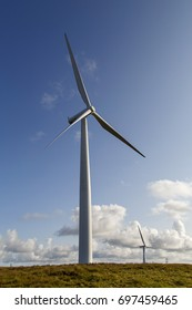 Wind Turbine in vertical format with blue sky - Clean Energy