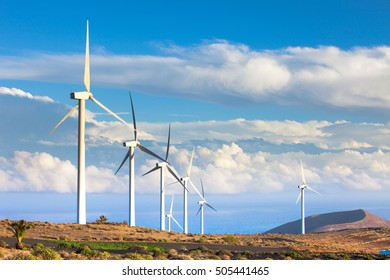 wind turbines against the blue sky in eolic farm , electric wind generators, renewable energy