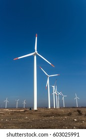 Wind turbines  against a blue sky generating electricity - concept of sustainable development