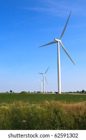 Wind Turbines against a Blue Sky in a Rural Setting