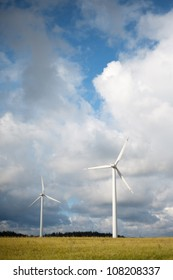 Wind turbines against stormy sky.