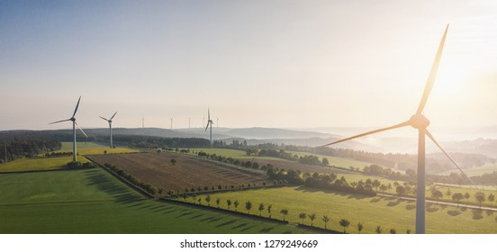 Wind turbines and agricultural fields - Energy Production with clean and Renewable Energy - copyspace for your individual text, banner size