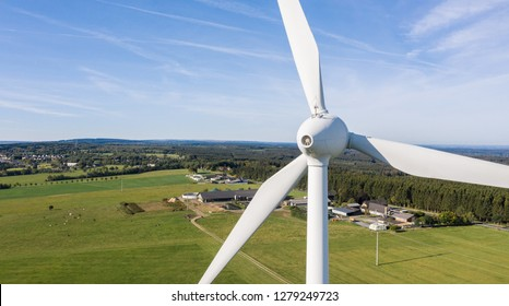Wind turbines and agricultural fields on a summer day bleu sky - Energy Production with clean and Renewable Energy - aerial shot, copyspace for your individual text