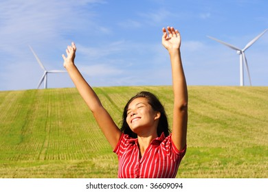Wind turbines. Beautiful woman by wind turbines in Denmark.