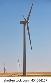 Wind turbines in the countryside. Clean alternative renewable energy. Vertical