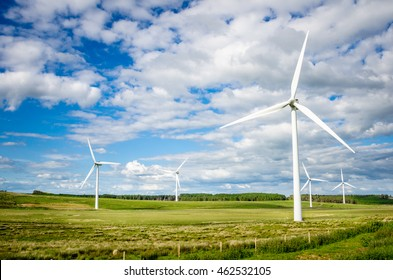 Wind Turbines in the Countryside of England and Cloudy Sky