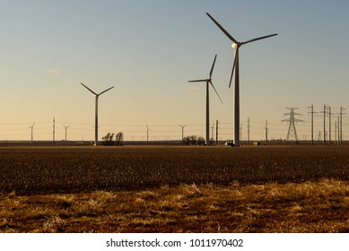 wind turbines in the desert with a blue sky