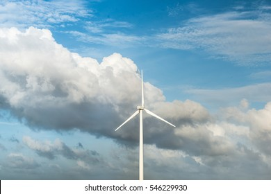 Wind turbines. Ecology wind against cloudy sky background with copy space