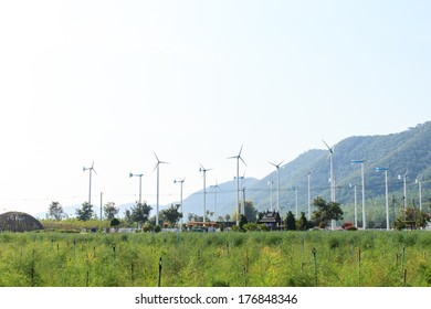Wind turbines in farm and mountain background-2