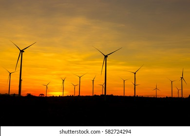 Wind turbines farm  power generator at the sunset