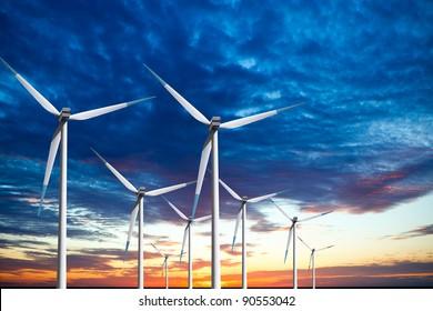 Wind turbines farm at sunset