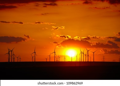 Wind turbines farm at sunset in Dobrogea region of Romania.