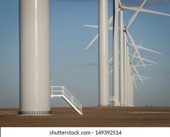 Wind turbines farm at sunset in Limon, Colorado.