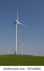 Wind turbines in the farmland with a clear blue sky