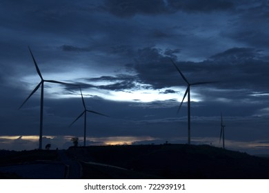Wind turbines farmland for generating electricity in Southeast Asia.