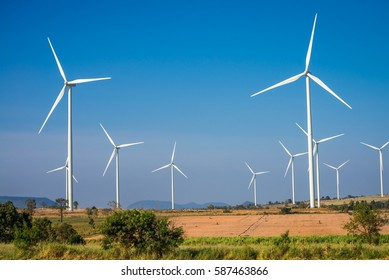 Wind turbines generating electricity with blue sky - energy conservation concept