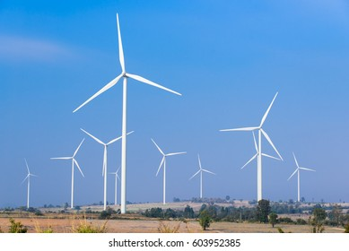 Wind turbines generating electricity with blue sky, renewable energy