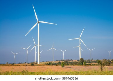 Wind turbines generating electricity - energy conservation concept