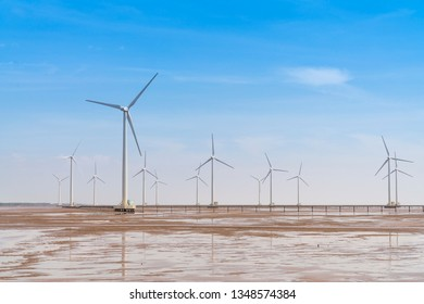Wind turbines generating electricity on the sea at Bac Lieu, Vietnam - January 26, 2019:  Seascape with Turbine Green Energy Electricity, Windmill for electric power production, Wind turbines generati