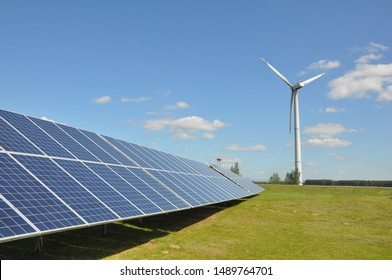 Wind turbines generating electricity and solar panels - energy saving concept