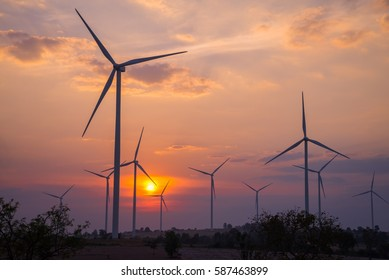 Wind turbines generating electricity in twilight evening sunset