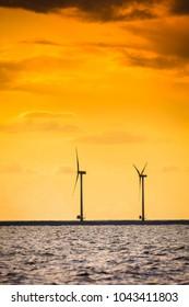 Wind turbines generator farm for renewable sustainable and alternative energy production along coast baltic sea near Denmark. Eco power, ecology.