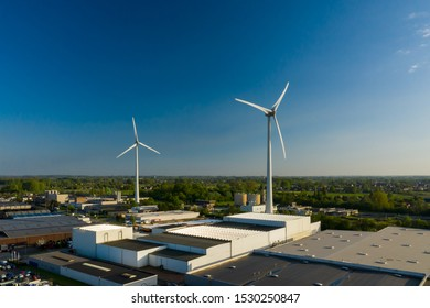 Wind turbines in an industrial area in Dendermonde, Belgium