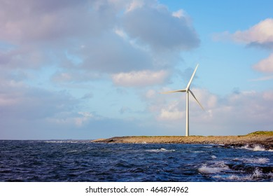 wind turbines in Ireland stone beach