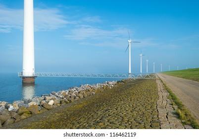 Wind turbines in a lake in a haze