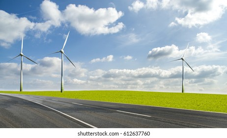 Wind turbines in landscape field beside a road against blue sky and clouds, alternative green energy