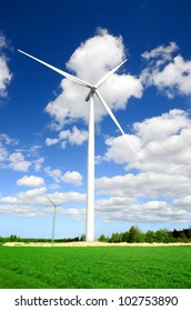 wind turbines at the meadow against blue sky