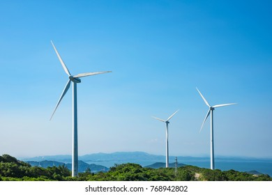 Wind turbines in the mountains near the sea